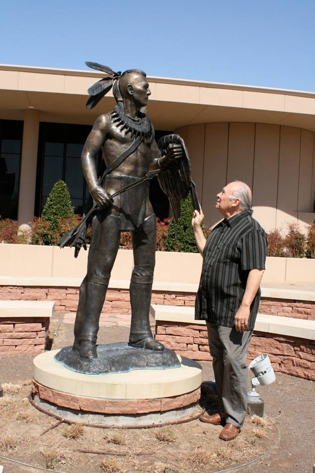 The Rt. Rev. Stephen Charleston views a sculpture of a Chickasaw warrior on the campus of Oklahoma City University. The sculpture was created by Native American Kelley Haney, who is also a Seminole Nation chief and a graduate of OCU. The sculpture, placed in the Chickasaw Nation Garden at the university, represents faith, persistence, resilience, and watchfulness—all values that Saint Paul School of Theology said it seeks to nurture in its Native American leadership development ministries. Photo by Bruce Bowdon for United Methodist Communications.