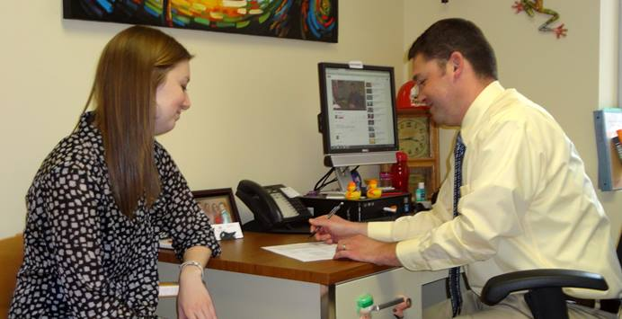 Ryan Brechbill, Director of the Center for Career & Professional Development at Otterbein University, advises student Haley Young, a public relations major. Photo by Marilyn Williams.