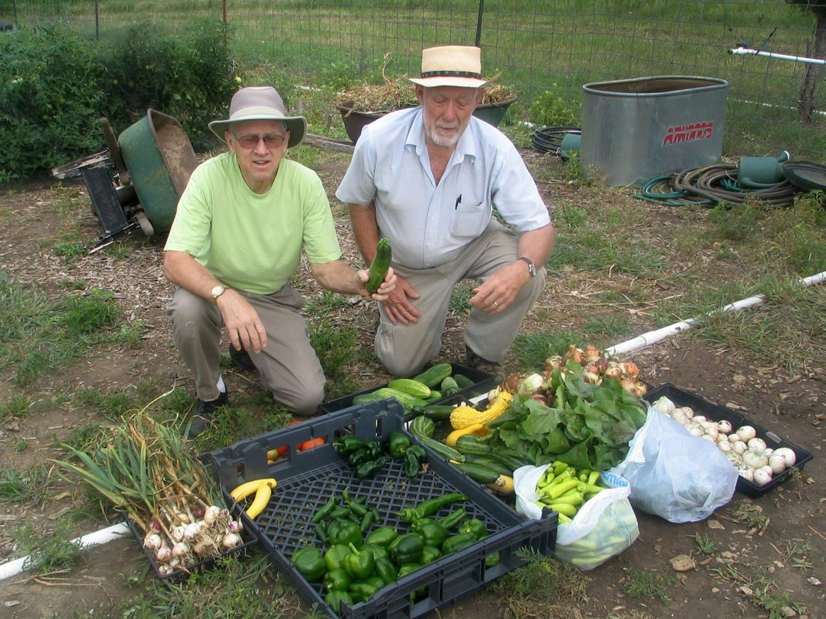 Two church volunteers, Dale Levy and Jay Sinnes, proudly display veggies from the Garden of Eatin' at Bartlesville First Church. The garden began during Change the World weekend in 2009. Photo courtesy of Bartlesville First Church.