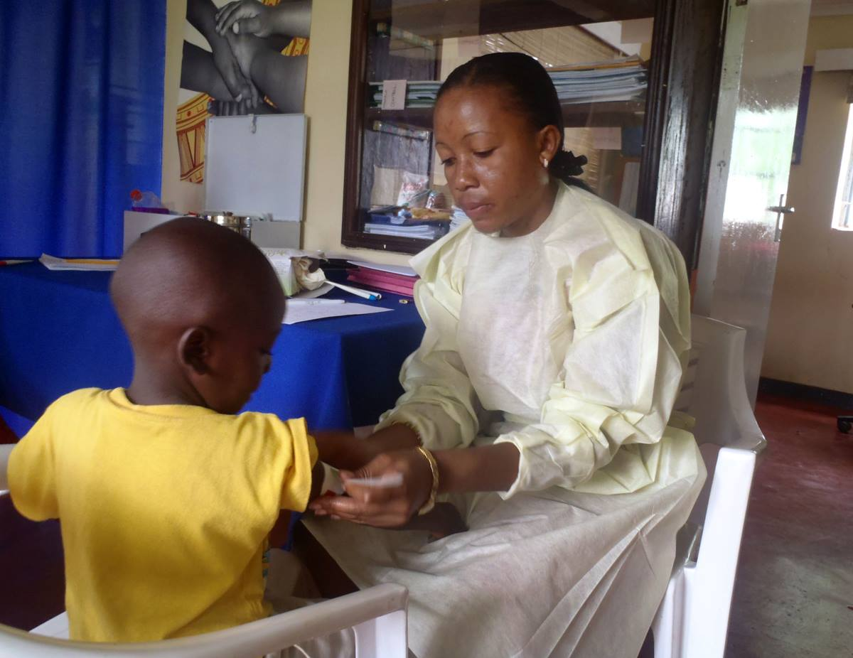Mercy Nyirongo treats a child in a clinic in her home country of Malawi. A 2010 graduate of Africa University with a bachelor's degree in nursing, Nyirongo is project manager for the ZOE orphan-empowerment program of The United Methodist Church in Malawi.Photo Courtesy Mercy Nyironga.