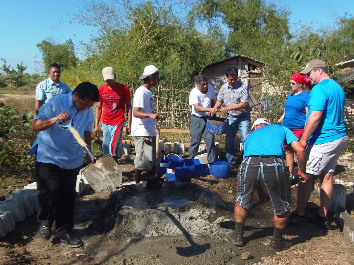 North Georgia Annual (regional) Conference work with Pangatian community members in Cabanatuan City, mixing concrete for the multipurpose hall foundation, as part of the conference's Bridges Philippines project. Photo courtesy of Wesleyan University-Philippines.