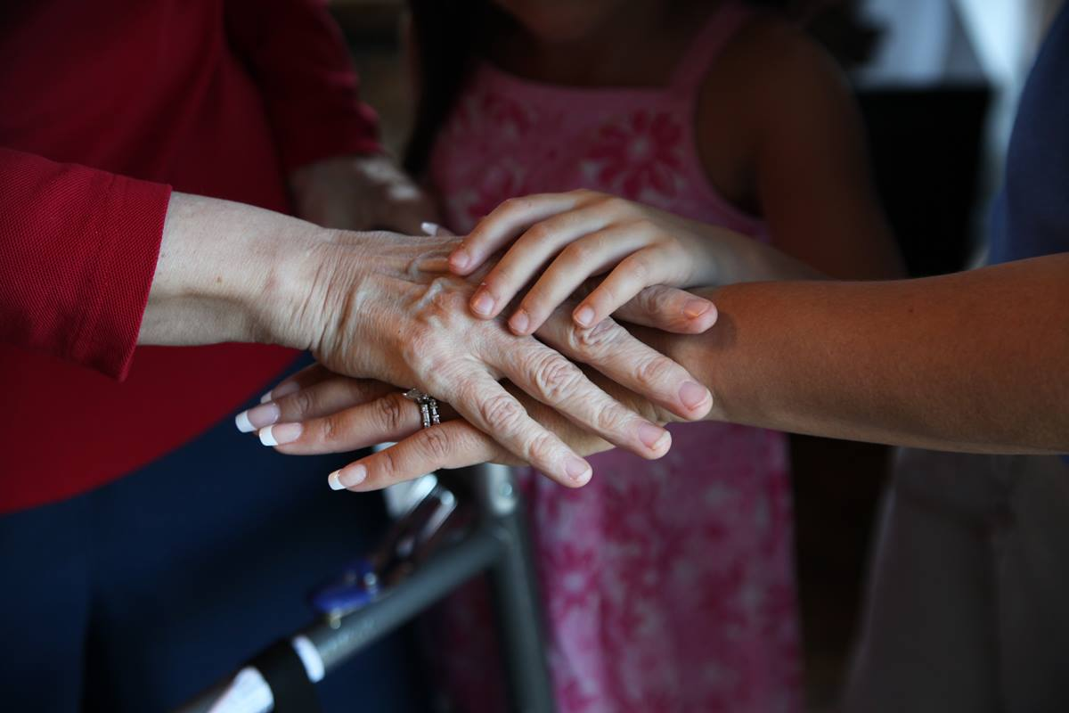 Three generations of hands; grandmother, mother and daughter. Photo illustration by Kathleen Barry, UMNS.