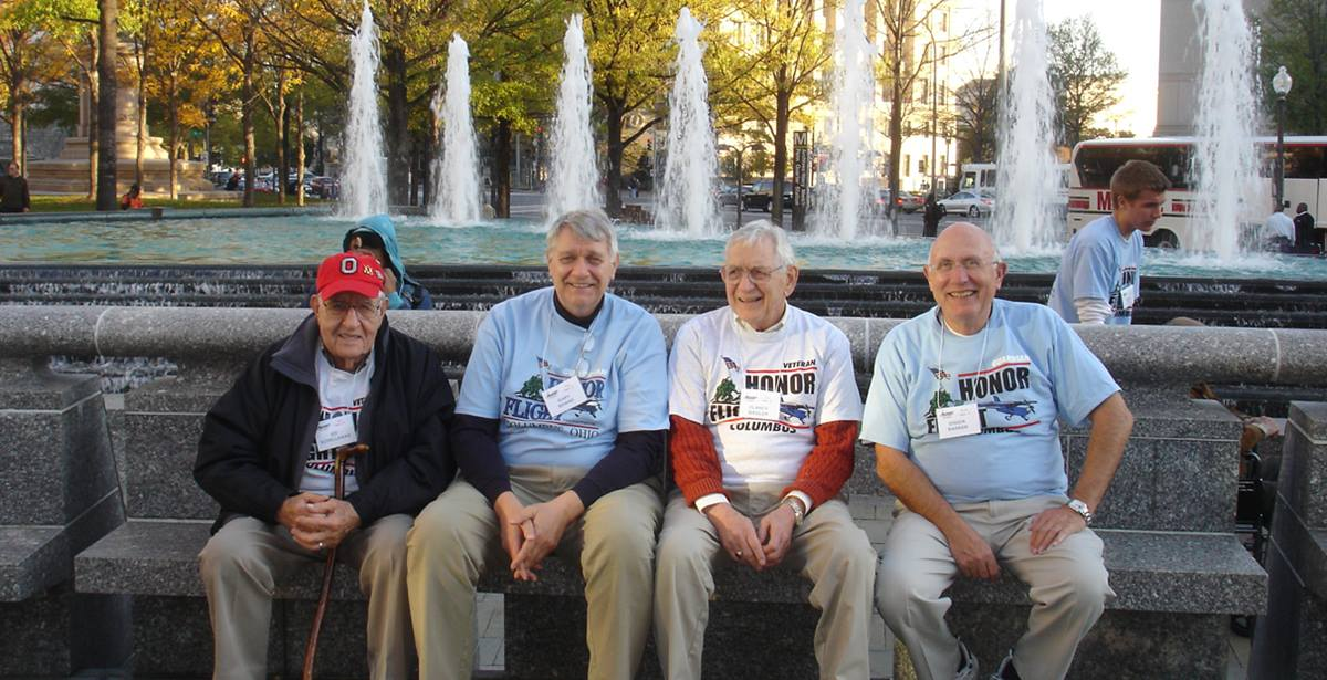 (From left) Ed Schellhaas, Gary Brand, Clancy Biegler, and Charles Barker, all members of Trinity United Methodist Church in Columbus, Ohio, traveled to Washington as part of Honor Flight. Biegler was among the veterans on the flight; Brands, Schellhaas and Barker traveled as guardians. Photo by Jeff Fisher.