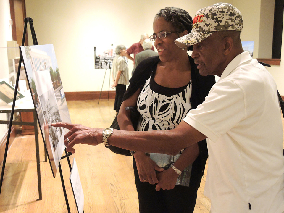 """Cheryl and William J. Claybrooks Sr. look at McCormack's photos during an exhibit at the library """"Because of You: An Evening of Photography and Literature Commemorating Nashville's Civil Rights Movement."""""""