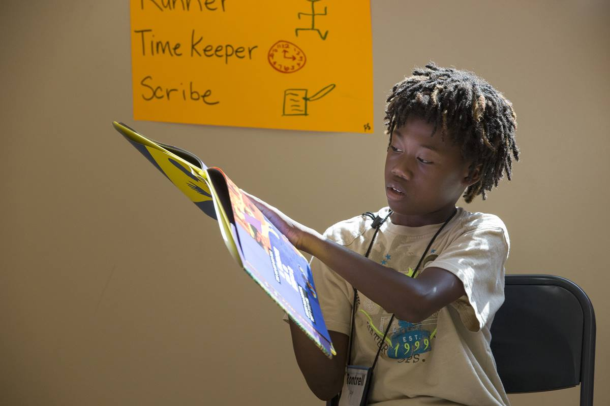 """Rontrell reads the book """"Looking Like Me,"""" during the Freedom School at Gordon Memorial United Methodist Church in Nashville, Tenn. The program, offered free to families, encourages stronger reading and writing skills among students in grades 5-8. Gordon is one of several United Methodist congregations across the United States hosting Freedom Schools this summer."""