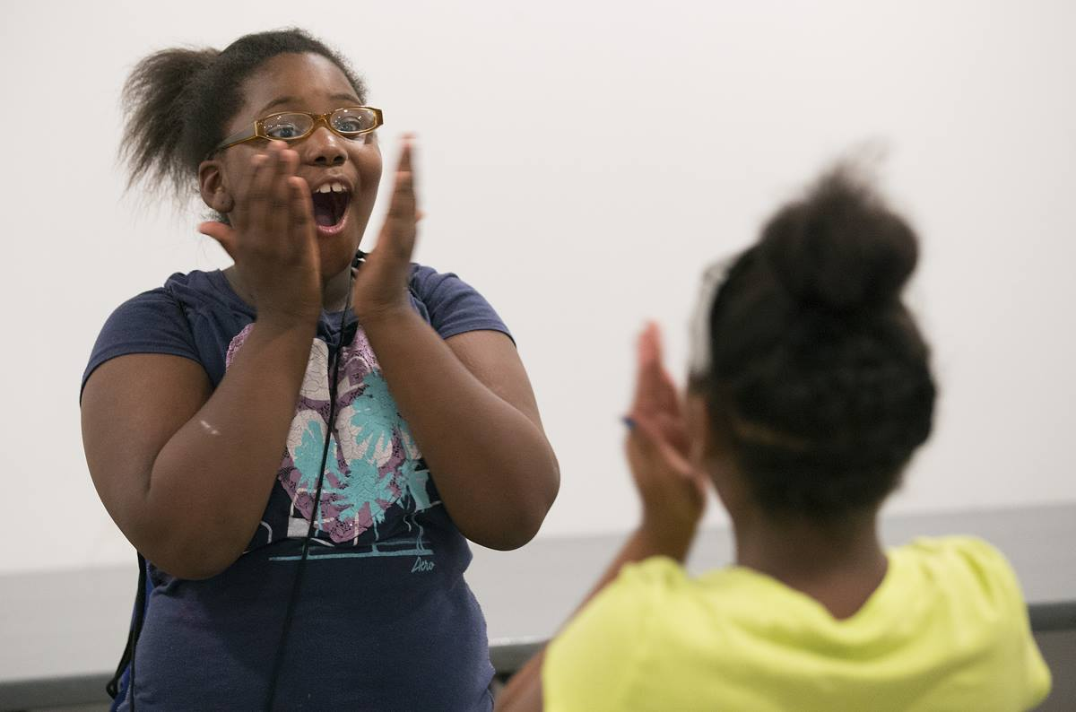 Kimiyah surprises herself by saying her chosen word loudly and with confidence during a vocabulary-building exercise at Freedom School at Gordon Memorial United Methodist Church in Nashville, Tenn.