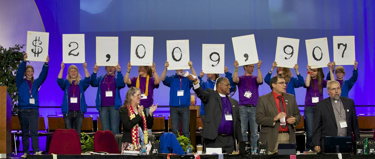 The Iowa Annual Conference celebrates surpassing the $2 million mark in its Imagine No Malaria campaign. Photo by Arthur McClanahan, Iowa Conference.