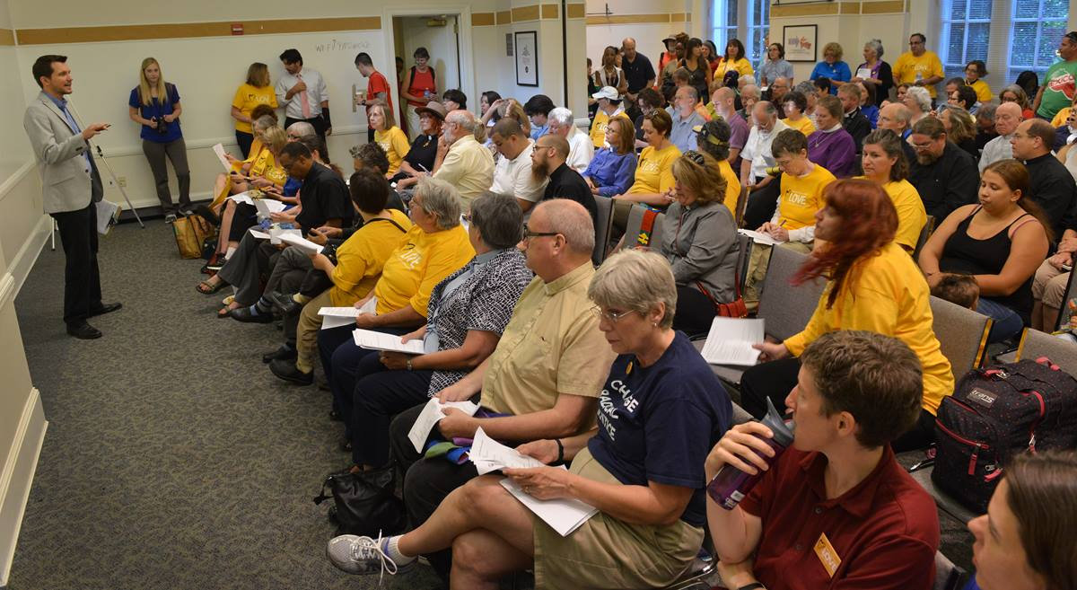 """Members of The United Methodist Church along with other faith leaders and immigration activists start a """"Day of Prophetic Action"""" on immigration policies with prayer at the United Methodist Building July 31."""