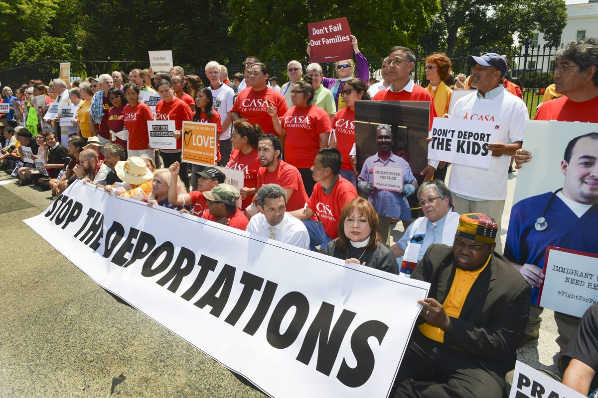 """Faith leaders and immigration activists protest in front of the White House during a """"Day of Prophetic Action"""" on deportation policies at the White House. More than 100 were arrested."""