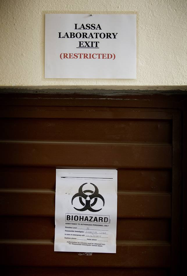 Signs warn of biological hazards in the Lassa fever laboratory at the government hospital in Kenema, Sierra Leone, where current efforts are centered on preventing the spread of the Ebola virus.