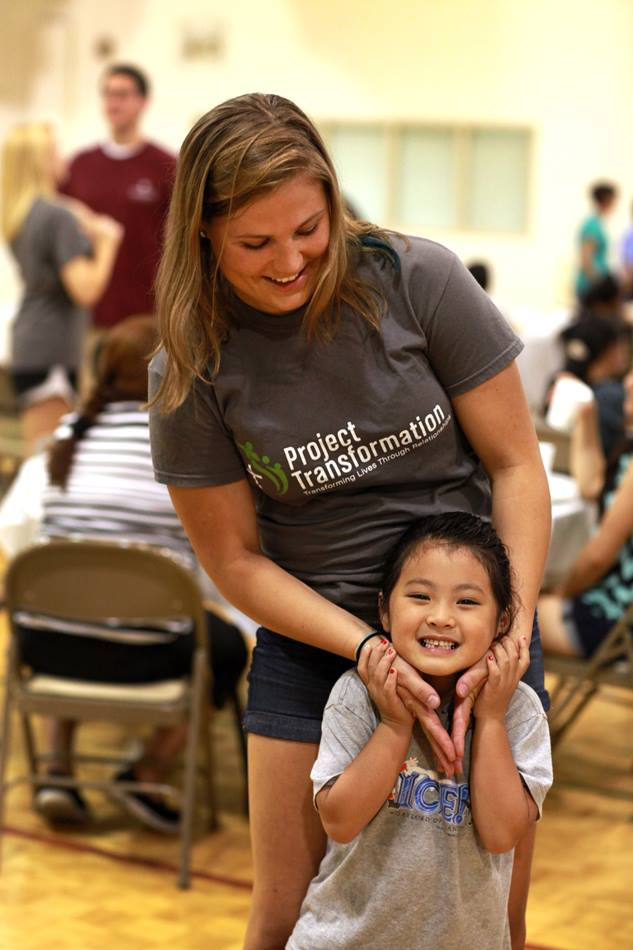 First year intern, Sarah Fuquay, shares a moment with a little girl at the Family Fun Night.  Fuquay is a sophomore at Butler University.
