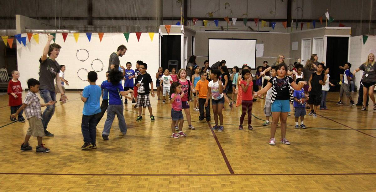 Music, movement and laughter abound in the gym at Antioch United Methodist Church during the Project Transformation Family Fun Night.