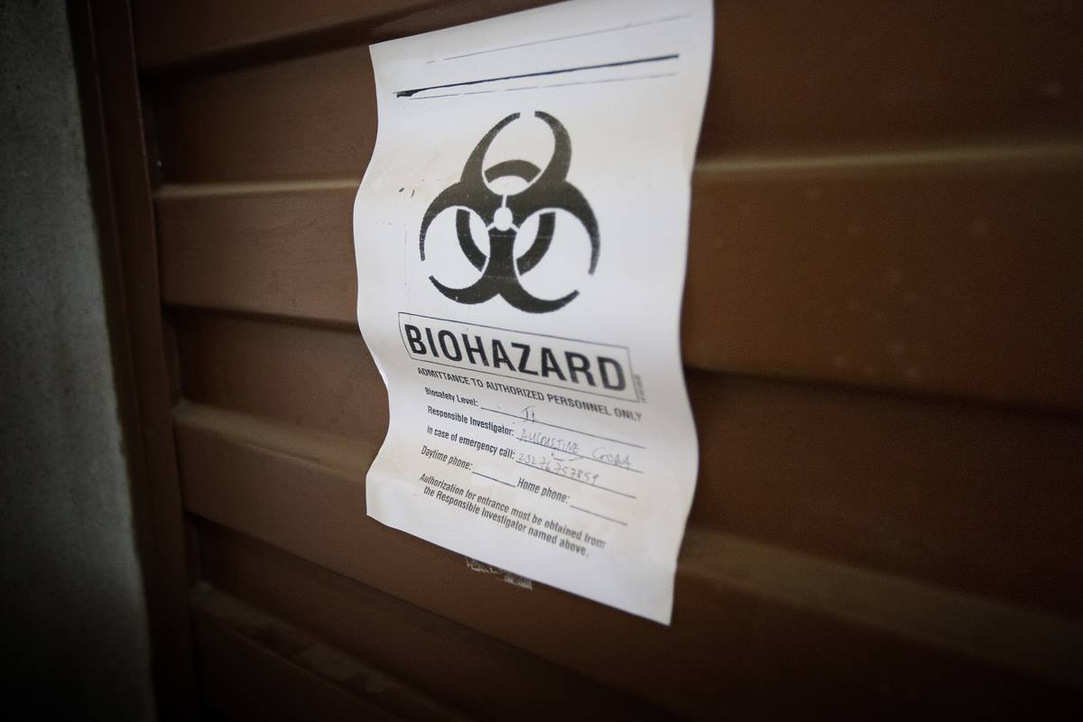 A sign warns of biological hazards in the Lassa fever laboratory at the government hospital in Kenema, Sierra Leone, where current efforts are centered on preventing the spread of the Ebola virus. United Methodist church leaders in West Africa are educating people about prevention, diagnosis and treatment of the disease.