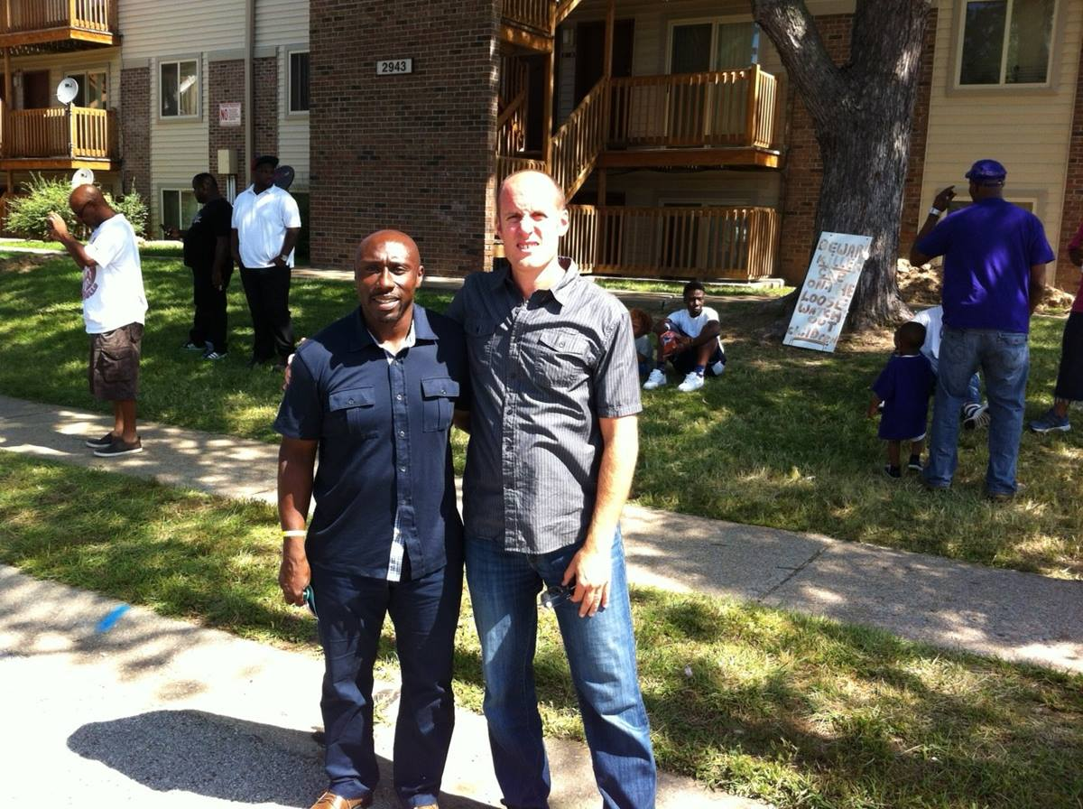 The Rev. Willis Johnson (left), pastor of Wellspring United Methodist Church in Ferguson, Mo., and the Rev. Matt Miofsky of The Gathering,  in the St. Louis area, stand near the site where Michael Brown was killed  in August, 2014. Photo courtesy of the Rev. Matt Miofsky.