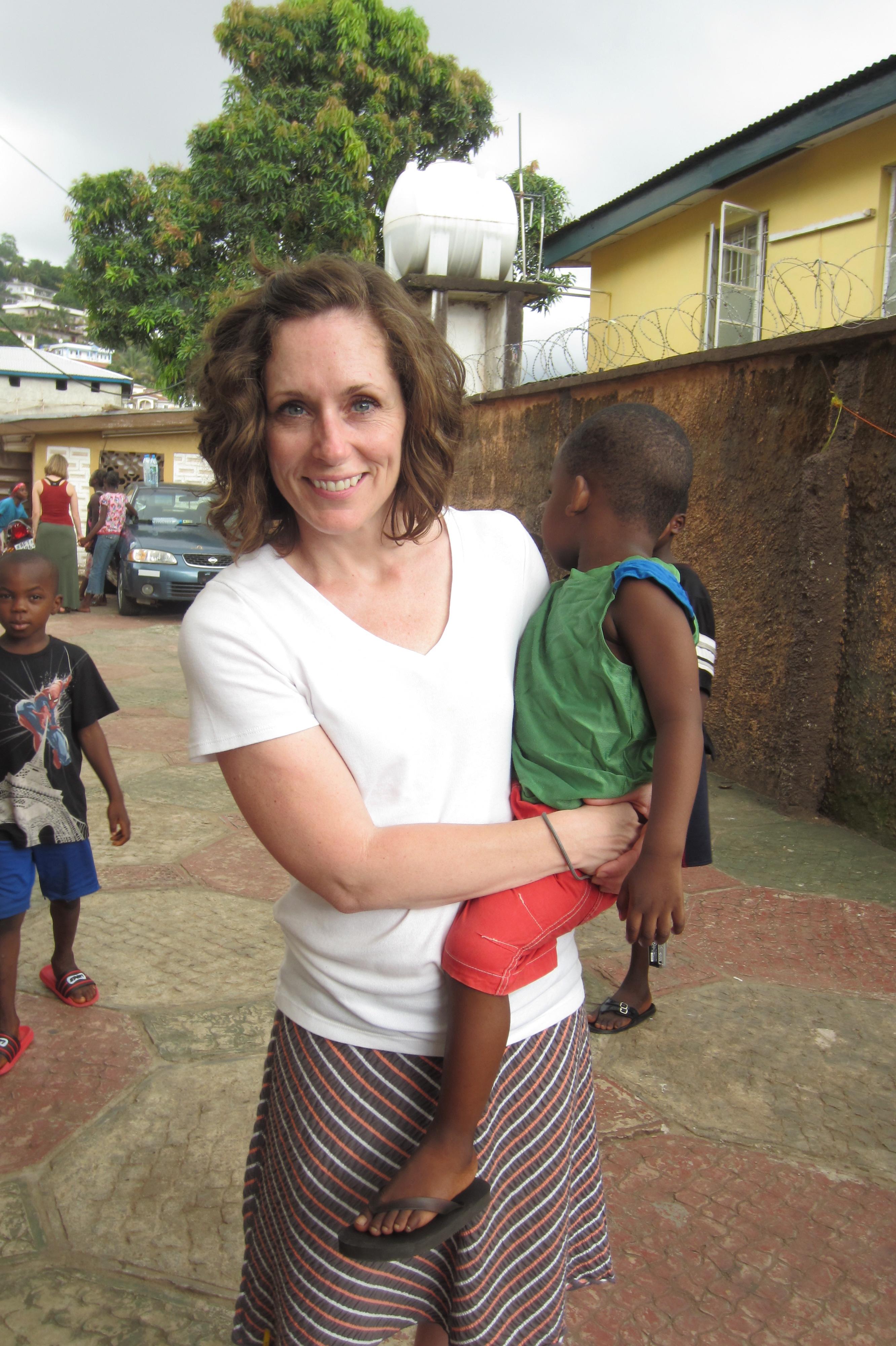Debbie Bonn holds a resident of The Raining Season orphanage in Freetown, Sierra Leone.
