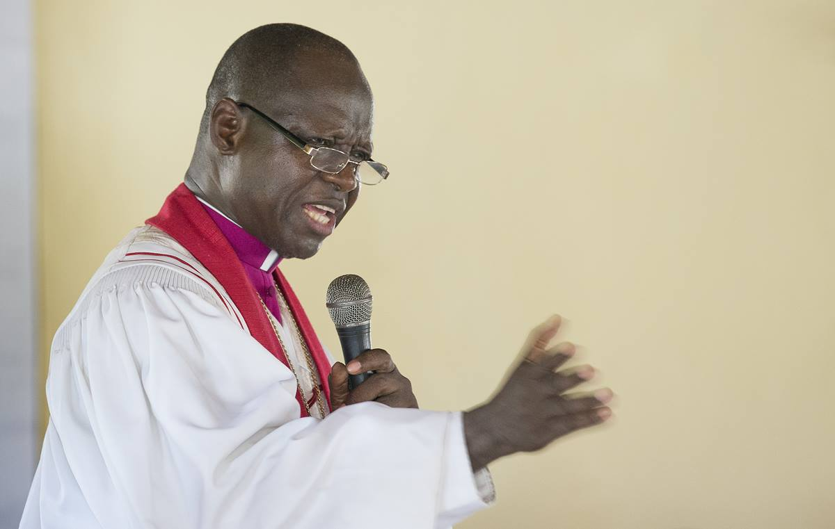 Bishop John K. Yambasu leads a service of dedication at Valunia United Methodist Church in Monghere, outside Bo, Sierra Leone.