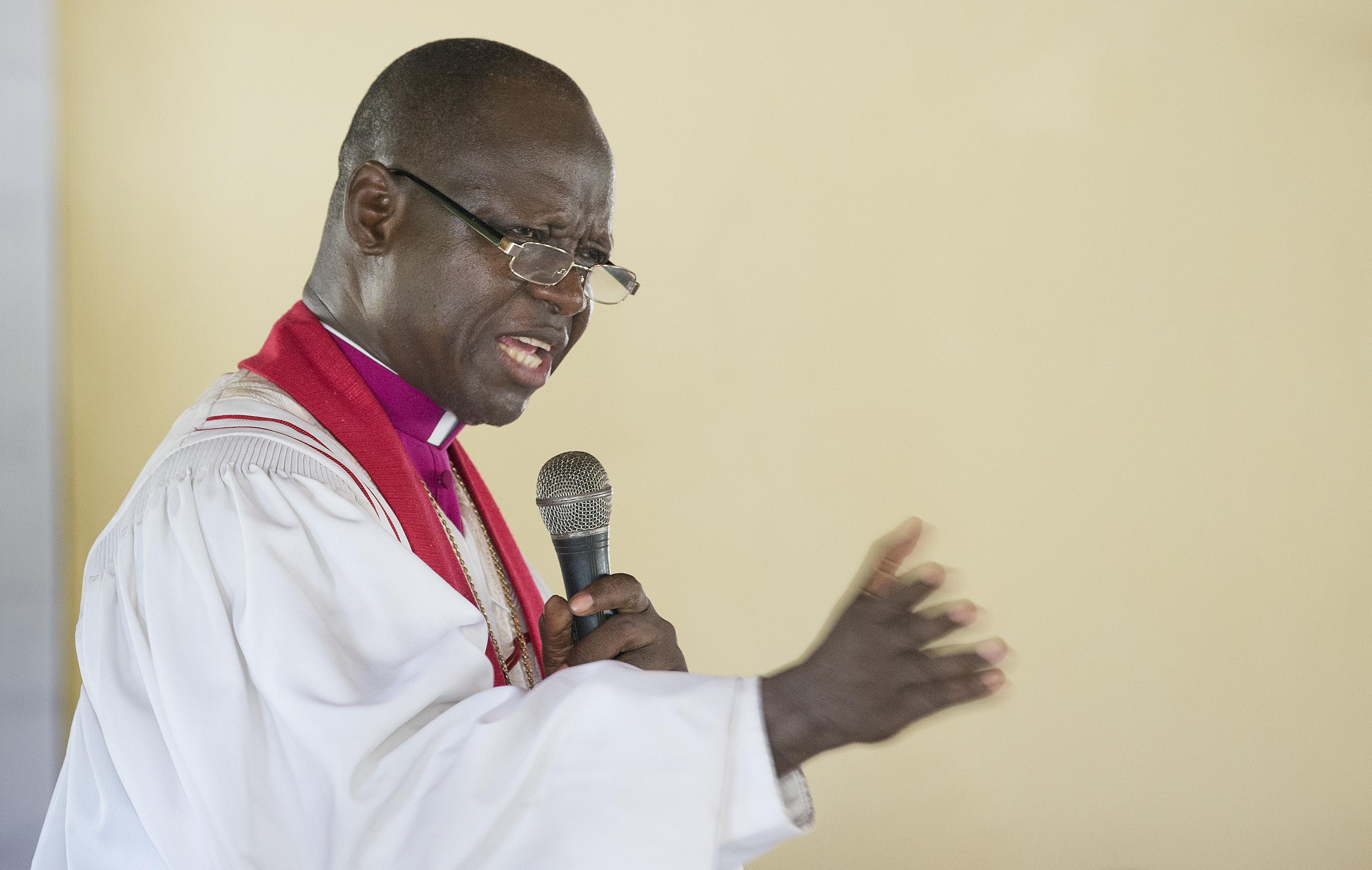 Bishop John K. Yambasu leads a service of dedication at Valunia United Methodist Church in Monghere, outside Bo, Sierra Leone.