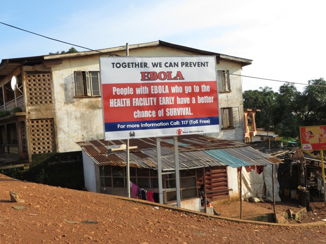 Ebola information billboards are displayed by government health partners. Photo by Phileas Jusu