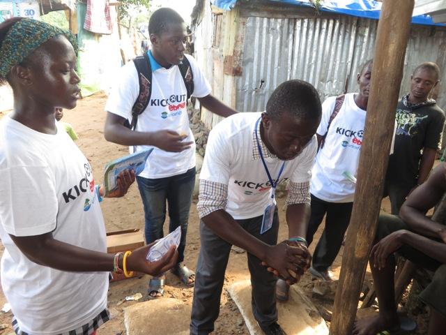 Volunteers demonstrate hand-washing at a slum near Juba in Freetown. Photo by Phileas Jusu