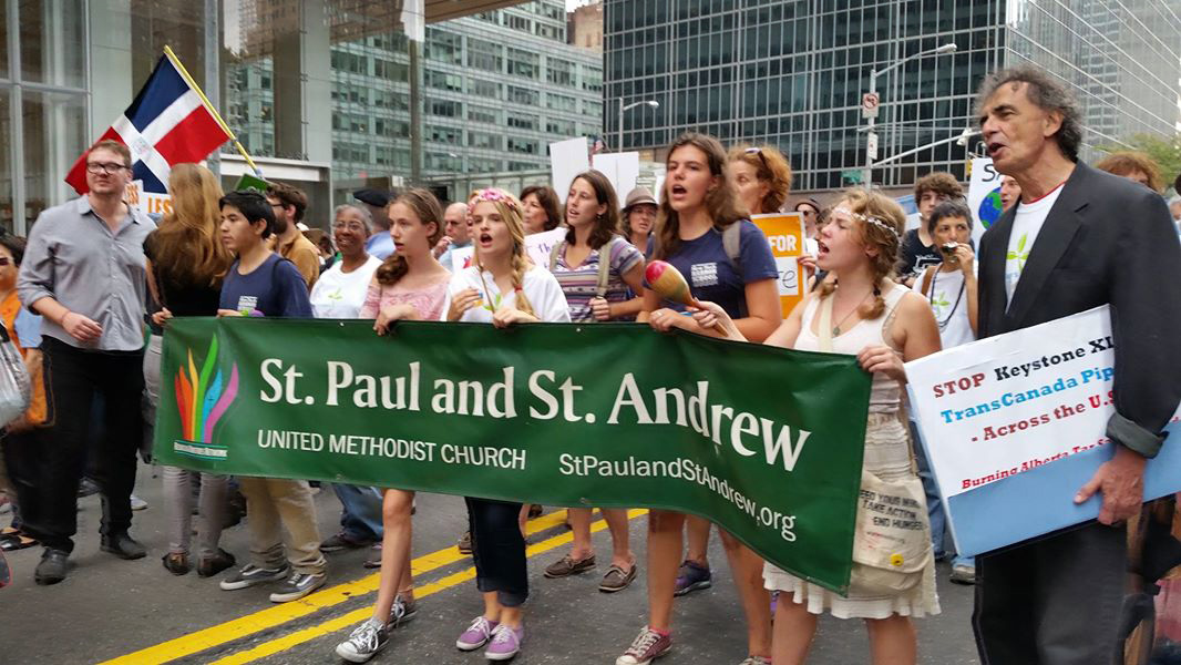 Members of the United Methodist Church of Saint Paul and Saint Andrew make their presence known as they walk in the People's Climate March Sept. 21 in New York. Photo by James K. Karpen, UMNS