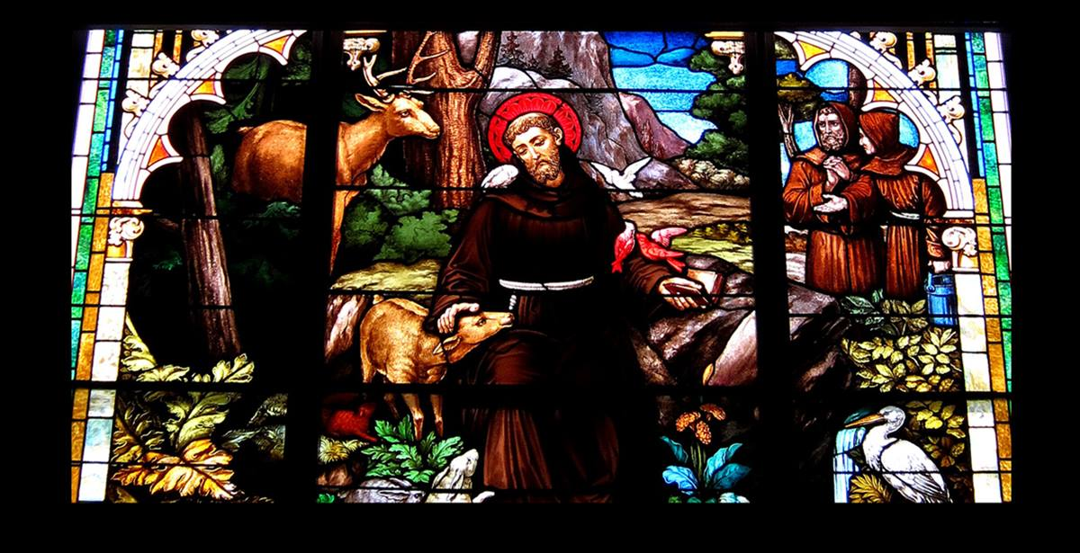 Close up of photo shows stained glass window in St. Francis Catholic Church in Cranberry Prairie, Ohio. Original photo by Nheyob, courtesy Wikimedia Commons.