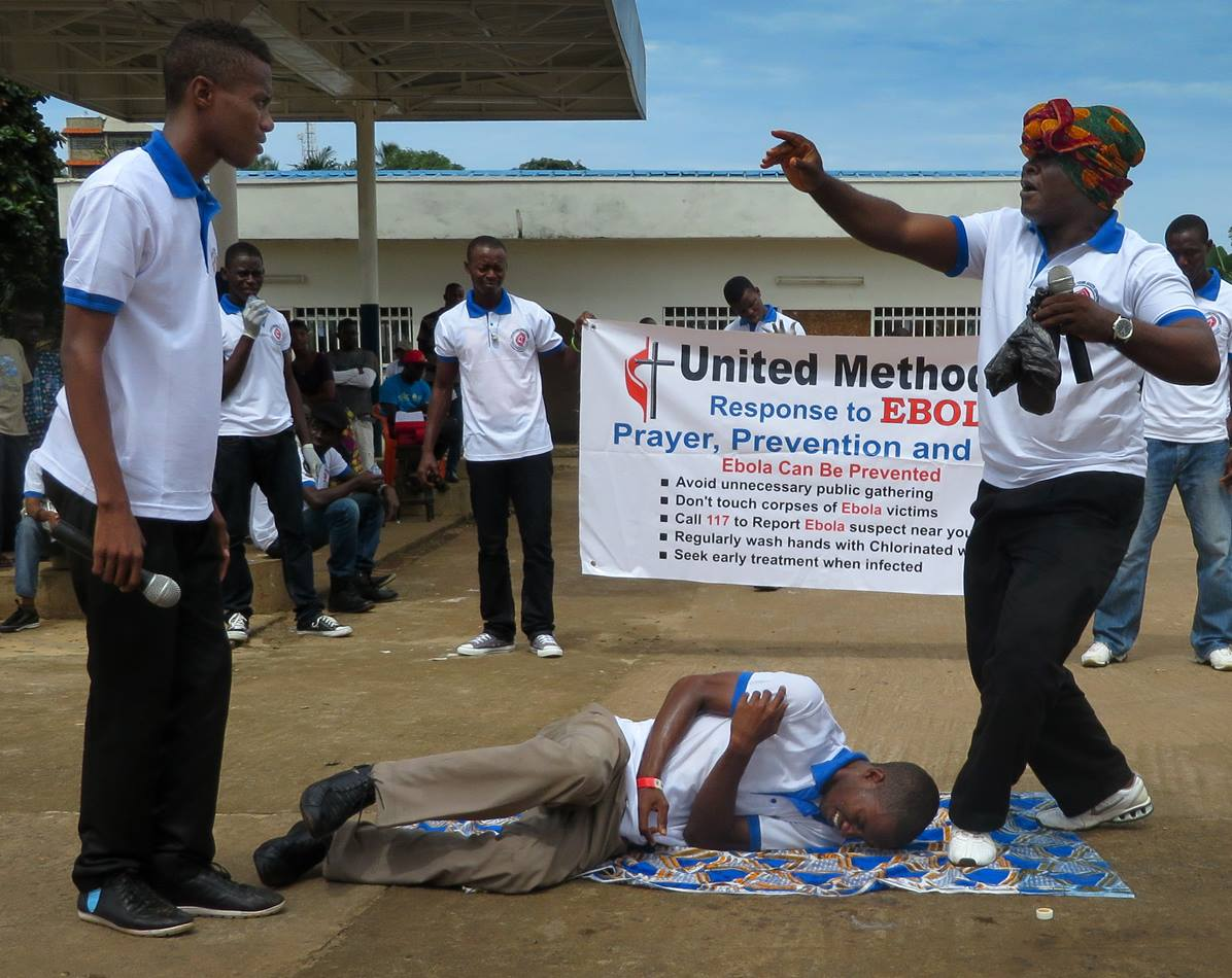 Young adults from the Sierra Leone Annual Conference act out skits relating the Ebola virus prevention and treatment in effort to educate.