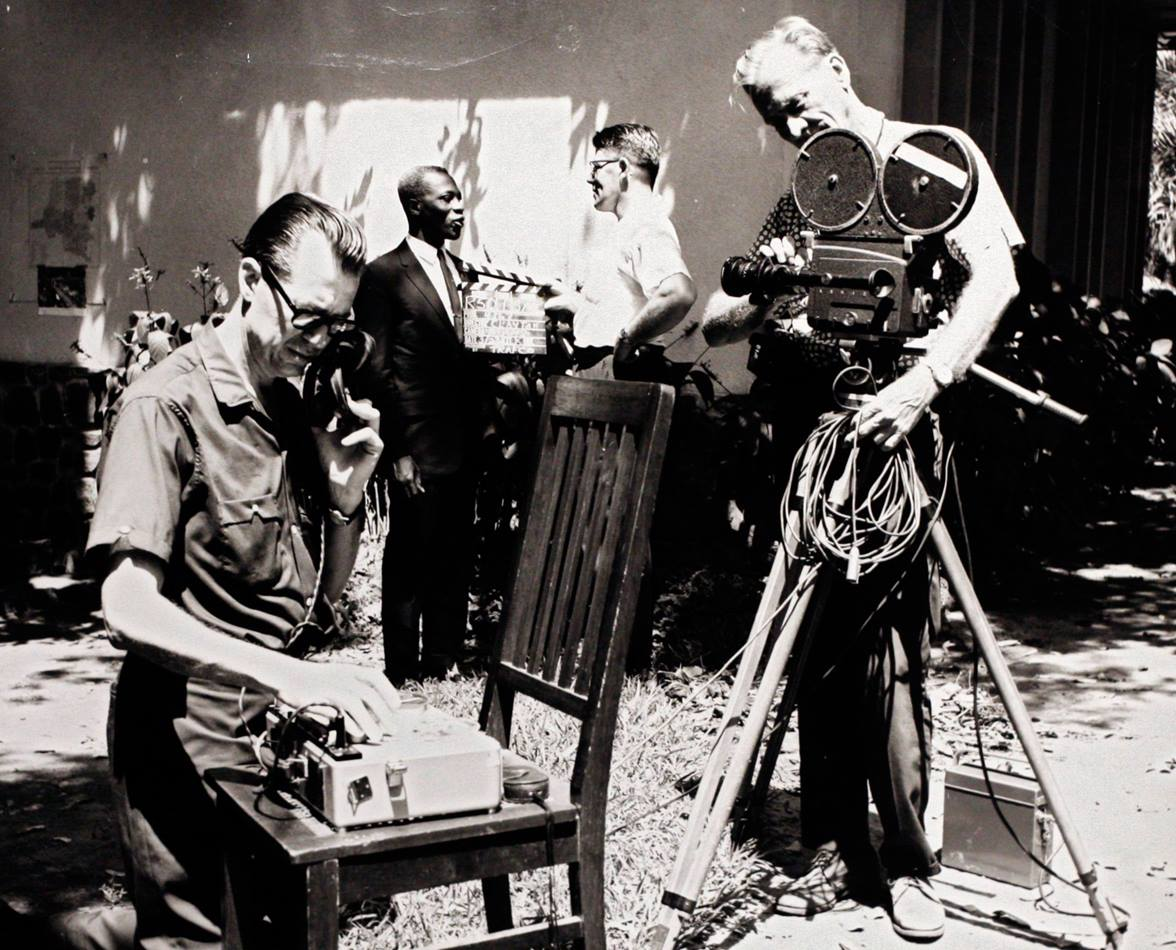 Ben Logan (left) a producer and writer for the church's communication agency, runs sound recording equipment during a motion picture shoot in this undated file photograph. Photo from United Methodist Communications archives.