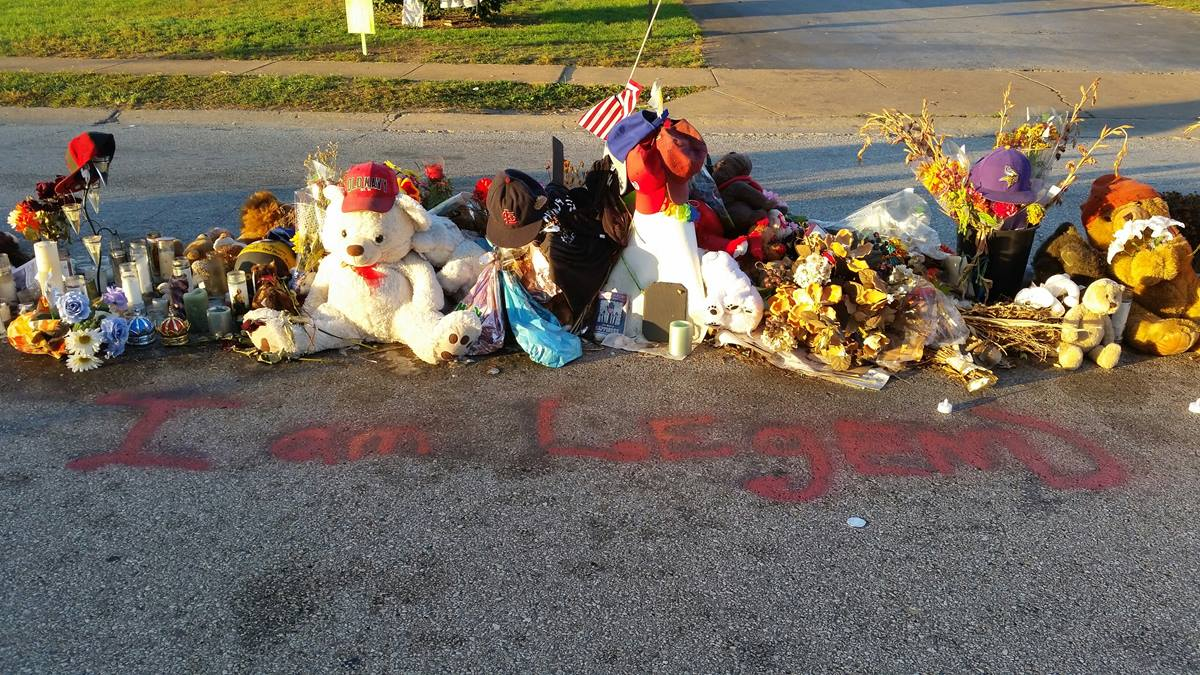 A memorial rests on the site of the shooting of Michael Brown in Ferguson, Mo. Johnson runs to the site and says a prayer most Sundays mornings. Photo by F. Willis Johnson