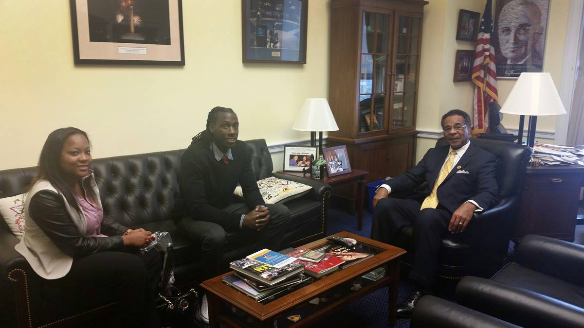 U.S. Rep. Emanuel Cleaver II, D-Mo., and a United Methodist elder, meets with young adults, Akyiah Phillips and Brandon Hart, in his Capitol Hill office on September 25. Phillips and Hart are members of Wellspring Church and part of the church's college-age ministry Yes to God. Photo by F. Willis Johnson