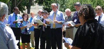 Participants gather in prayer support for a