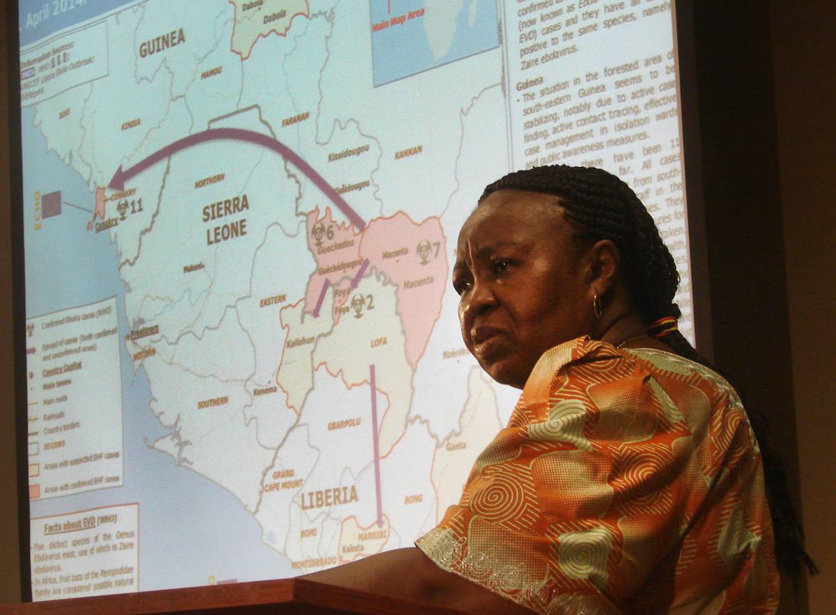 During the briefing, Beatrice Gbanga shows a map of Sierra Leone. Photo by Sam Hodges, UMNS