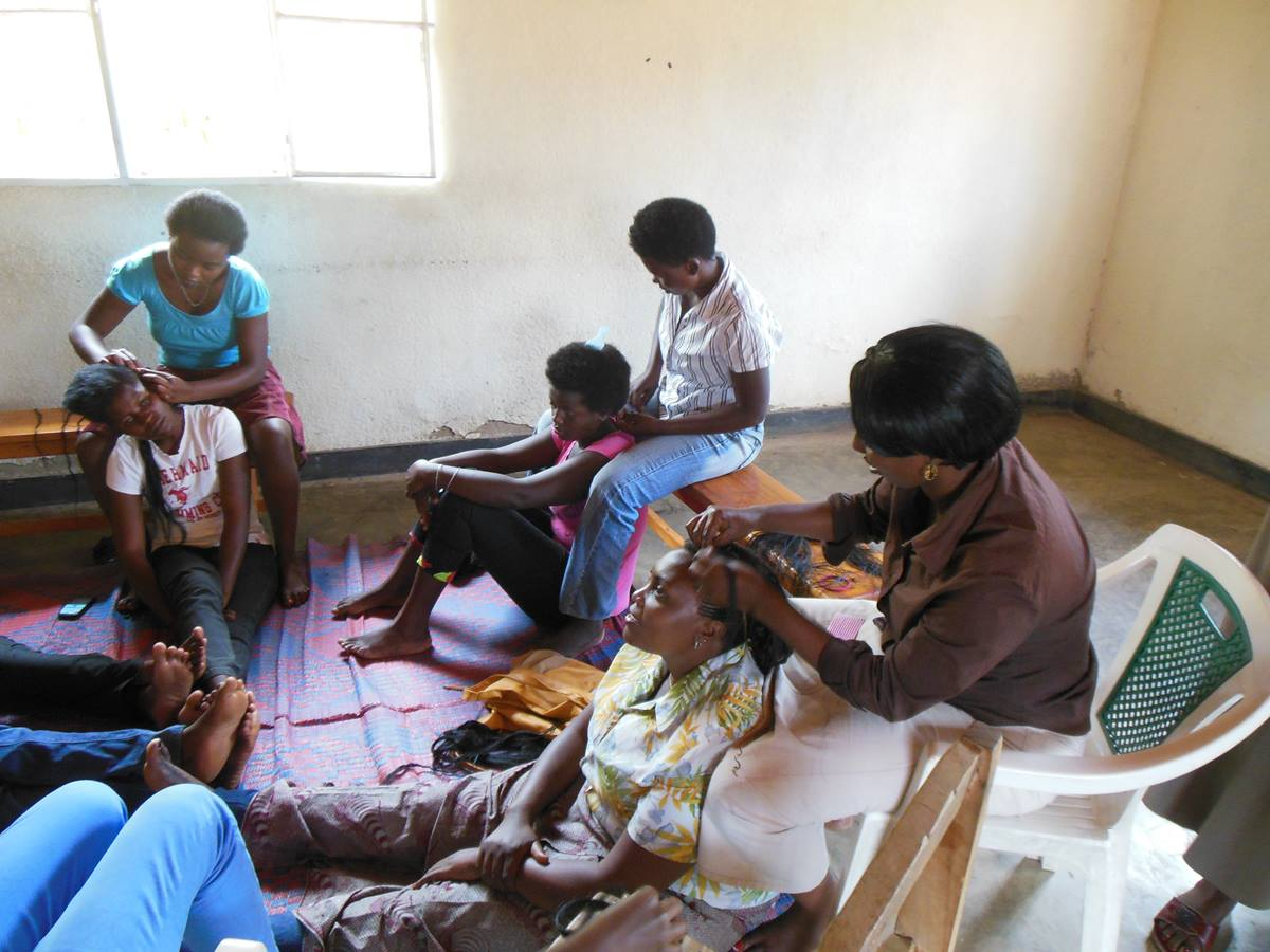 """Women in Kigali, Rwanda, learn skills such as hairstyling as part of an economic empowerment project of Mbwirandumva, """"Speak I'm Listening,"""" for impoverished women. Photo courtesy of Don Messer."""