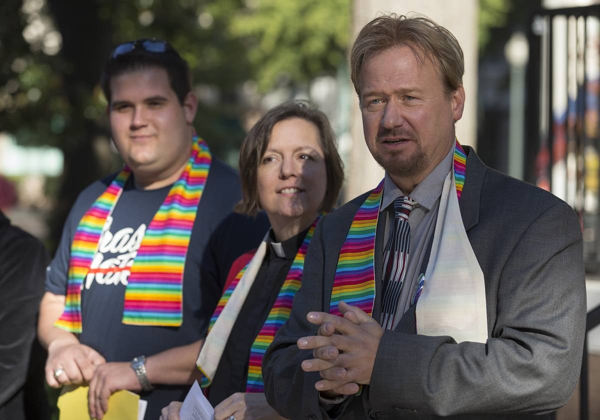 The Rev. Frank Schaefer (right) greets supporters during a prayer service for unity at Court Square Park in Memphis, Tenn., prior to his appearance before the United Methodist Judicial Council.