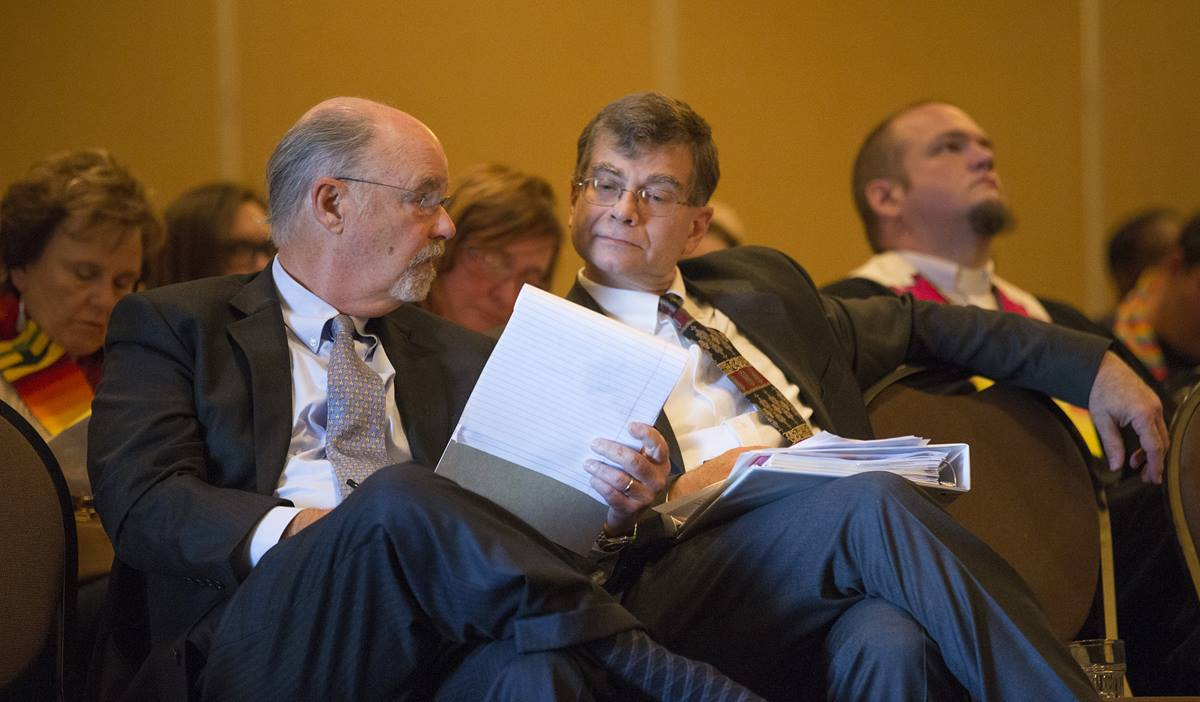 Robert Shoemaker (left) and the Rev. Christopher Fisher confer during an oral hearing before the United Methodist Judicial Council which will decide whether to uphold the reinstatement of the Rev. Frank Schaefer, who lost his credentials after being found guilty in a church trial last November of performing a same-sex wedding ceremony for his son. The hearing opened the council's Oct. 22-25 fall meeting in Memphis, Tenn.