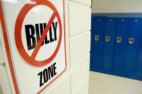 No bullying zone sign in school hallway. Photo by iStockphoto/Patrick Herrera.