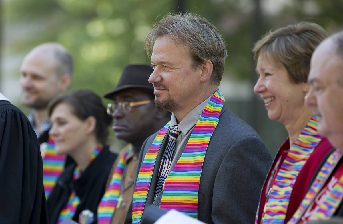 The Rev. Frank Schaefer (third from right) stands with family and supporters during a prayer service for unity at Court Square Park in Memphis, Tennessee, prior to the Oct. 22 oral hearing on his case by the United Methodist Judicial Council. Schaefer was found guilty in a November 2013 church trial of performing a same-sex wedding ceremony for his son but regained his clergy credentials upon appeal. Photo by Mike DuBose, UMNS.