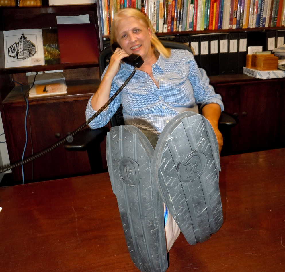 The Rev. Faith Fowler shows off her sandals, made from old tires by workers at Cass Community Social Service's Green Industries.  Photo courtesy of Faith Fowler
