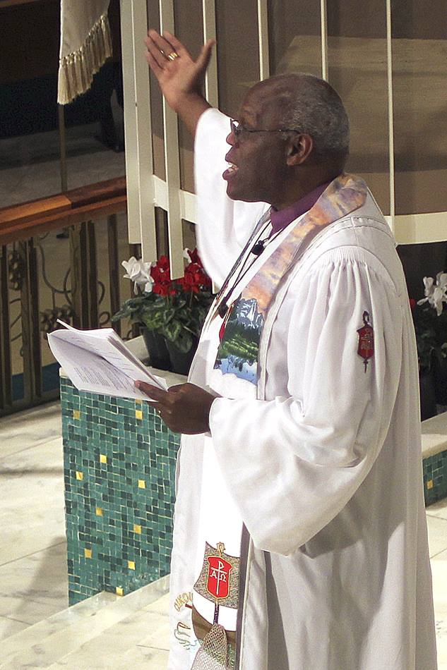 Bishop Warner Brown, president of the Council of Bishops, presides over Communion at St. Luke United Methodist Church in Oklahoma City. Photo by Holly McCray