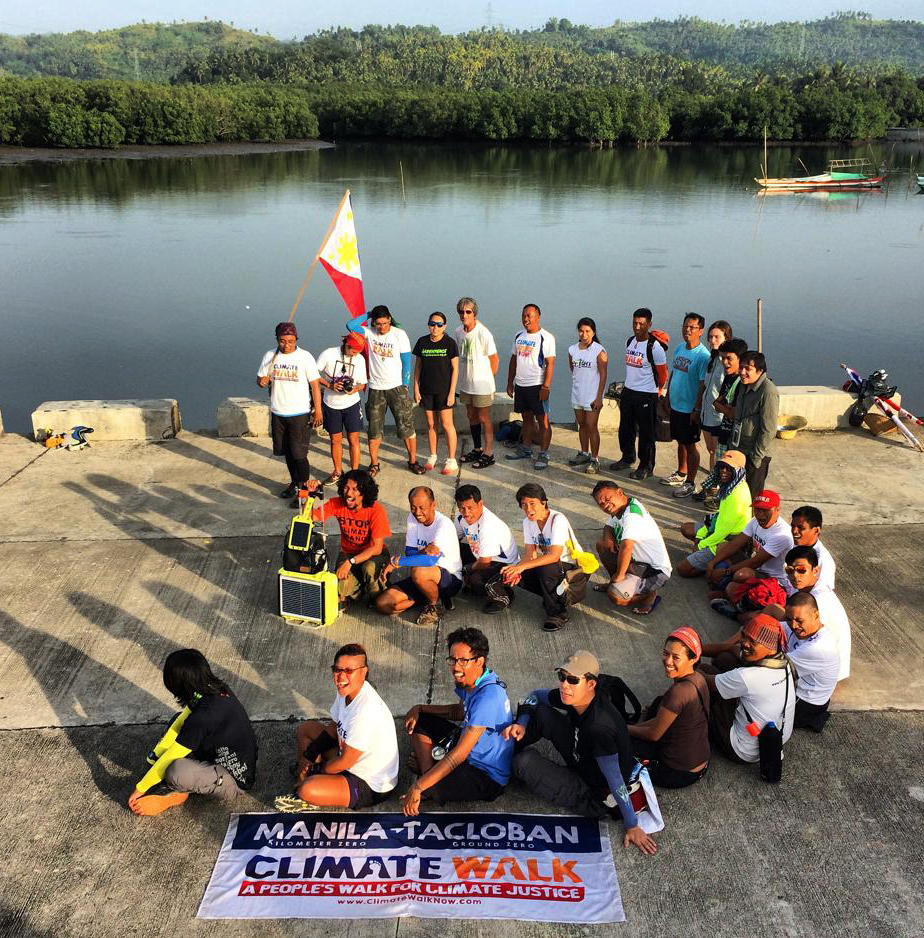 Marchers are walking for 40 days to call attention to how climate change effects on vulnerable countries like the Philippines. They are shown near Basey.