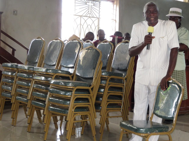 Men at the Charles Davis United Methodist Church purchased 40 new chairs to handle the increase in church attendance.  The church is located in in Western Freetown, Sierra Leone.