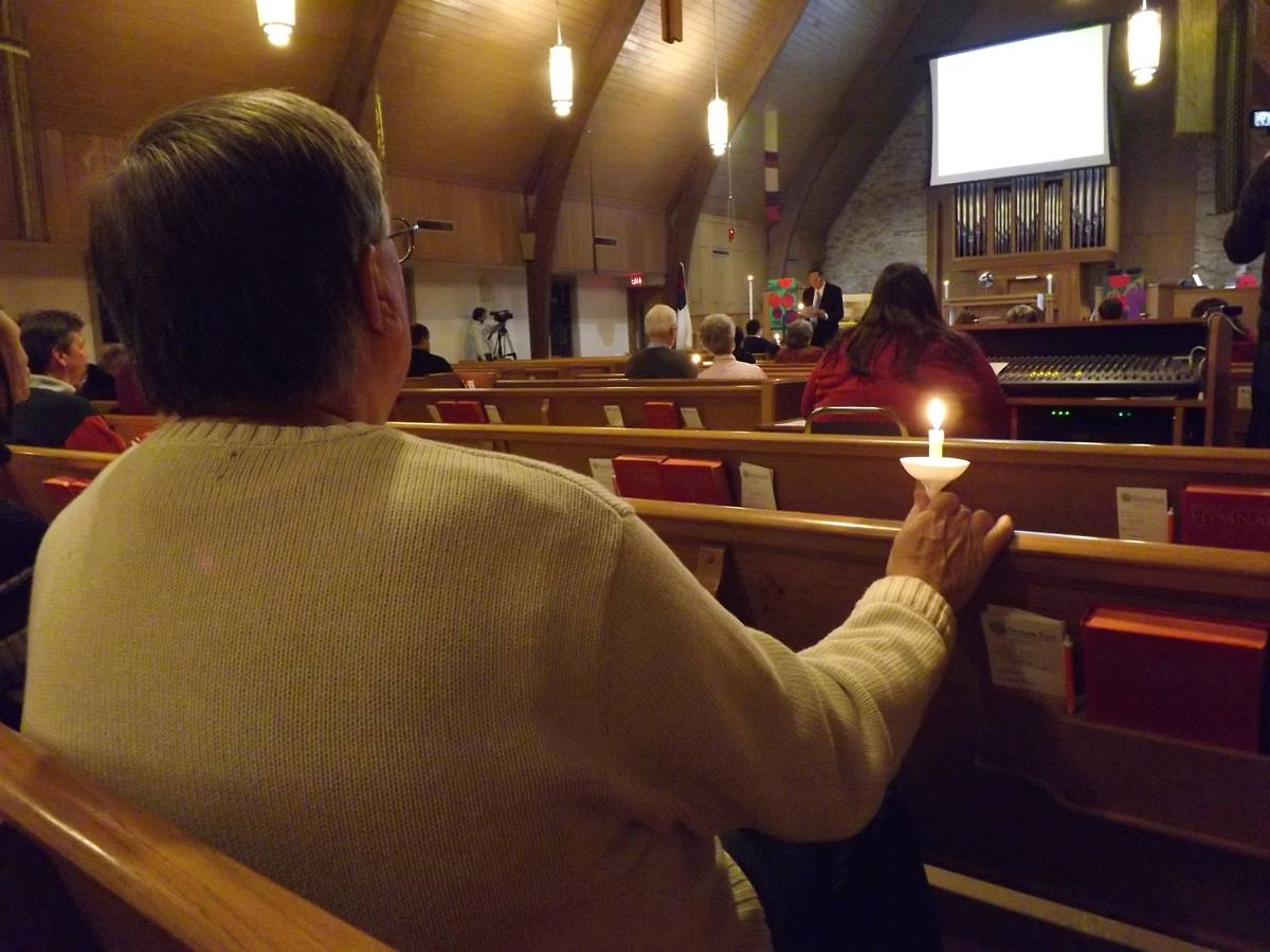 People gather to pray for Dr. Martin Salia at Hanscom Park United Methodist Church in Omaha, Neb., Nov. 16.
