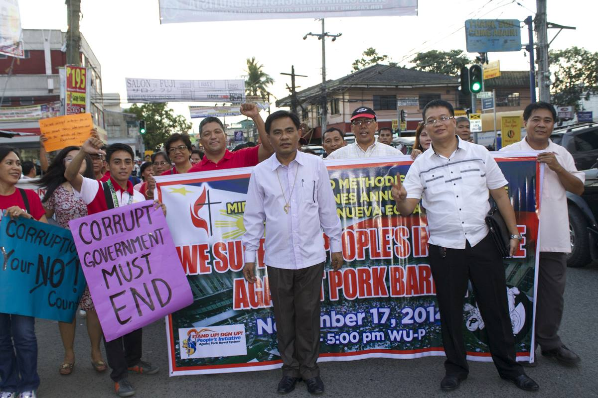 Bishop Rodolfo Alfonso Juan (center) of the Manila Area was instrumental in holding a liturgy, walk, and candlelight vigil against corruption in the government.  Photo courtesy of Gladys P. Mangiduyos