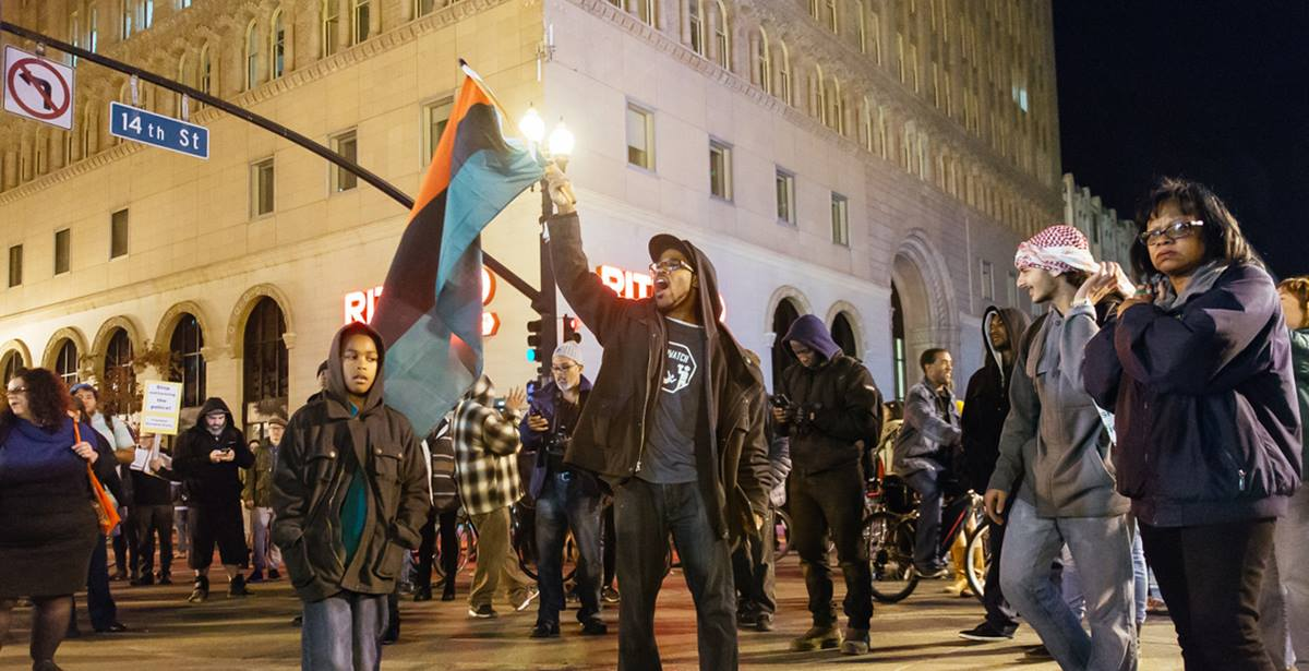 Peaceful protesters gather in Oakland, California following the no indictment decision for the killing of Michael Brown by police officer Darren Wilson in Ferguson, Missouri. Taken Nov. 24, 2014. Photo by Amir Aziz, courtesy of Flickr.