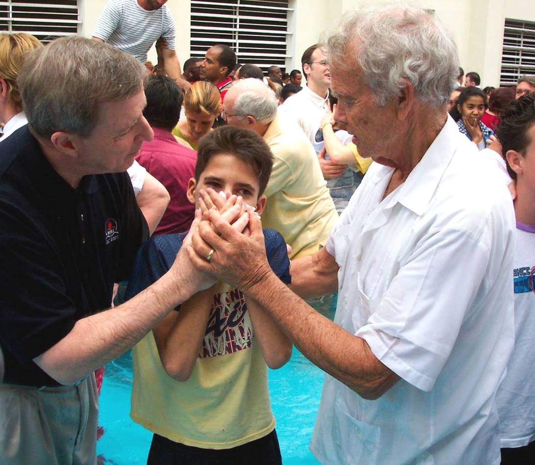 The Revs. H. Eddie Fox (right) and George Freeman join 50 other Wesleyan/Methodist clergy and bishops from throughout the Americas at a mass baptism of more than 200 adults and children in Havana in 2004.