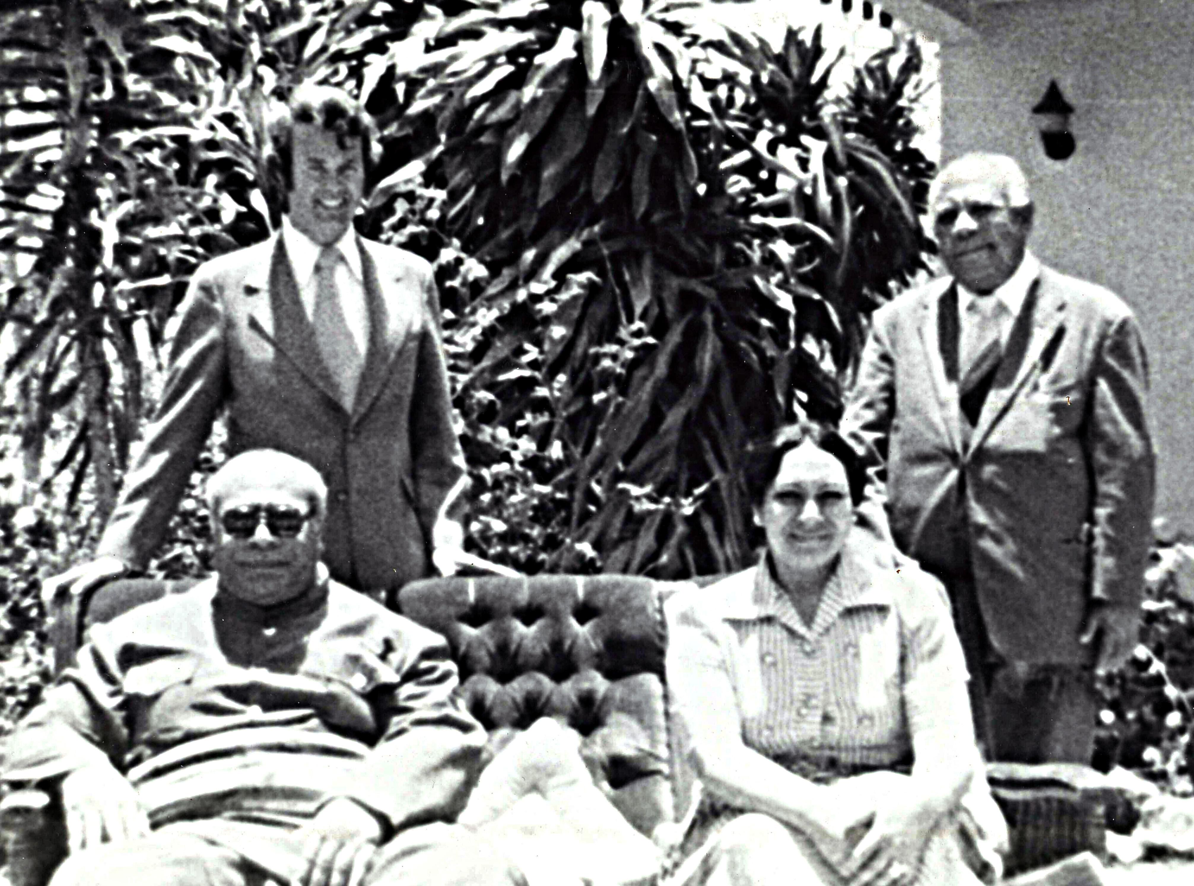 The Rev. H. Eddie Fox (left, rear) poses with King Tāufaʻāhau Tupou IV and Queen Halaevalu Mataʻaho ʻAhomeʻe of Tonga (seated) in 1975. Photo courtesy of the Rev. H. Eddie Fox