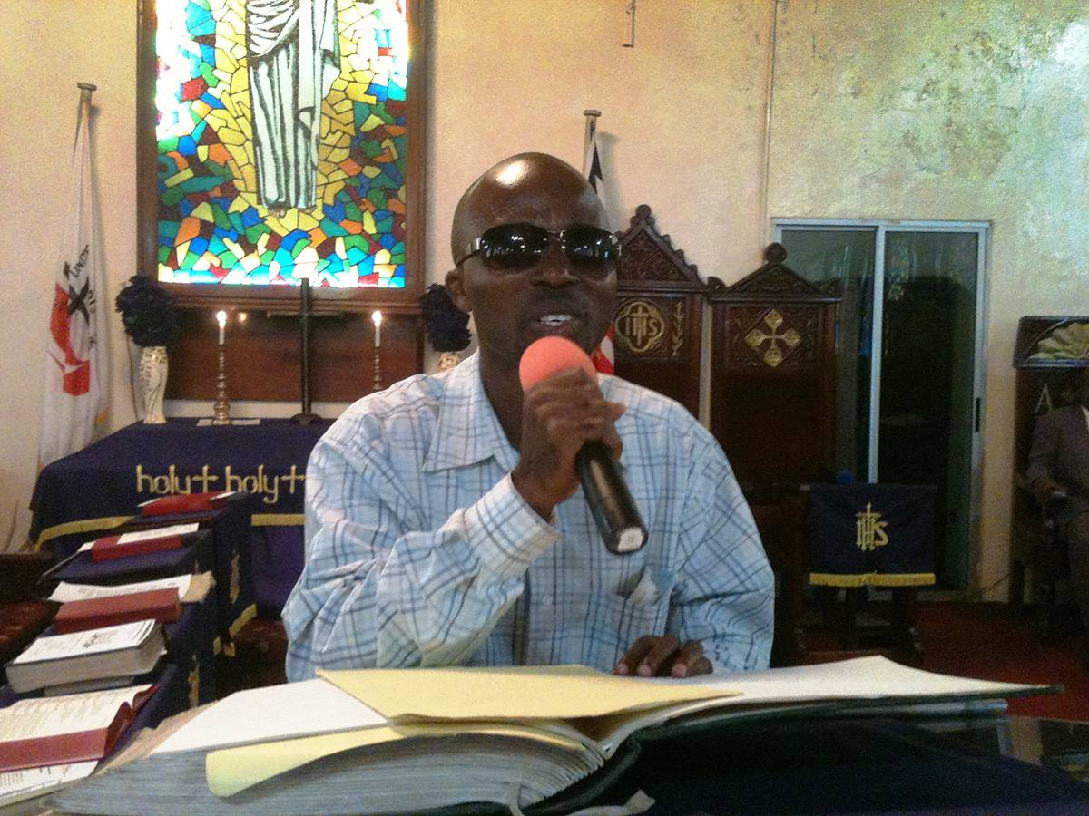 Joshua Shadra preaches using braille during the celebration of United Methodist Student Day at Stephen Trowen Nagbe United Methodist Church in Liberia.