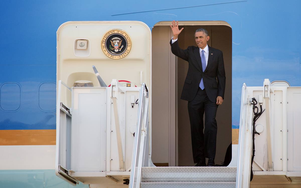 President Obama greets supporters from the doorway of Air Force One upon his arrival at Berry Field Air National Guard Base in Nashville, Tennessee. Obama spoke about his recent executive actions on immigration at Casa Azafrán, an immigrant community center.