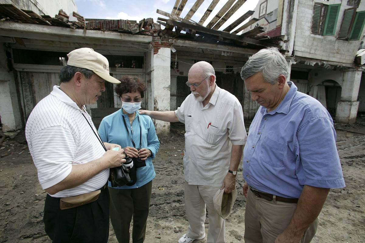 Members of a United Methodist delegation pray during a visit to Banda Aceh, Indonesia, three weeks after the tsunami. A UMNS photo by Mike DuBose.