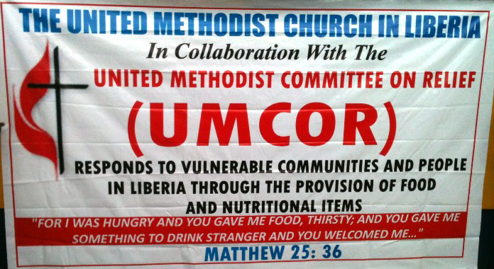 This banner was printed specifically for the purpose of the collaboration between The United Methodist Committee on Relief and The United Methodist Church in Liberia in on food distribution. Photo by Julu Swen, UMNS