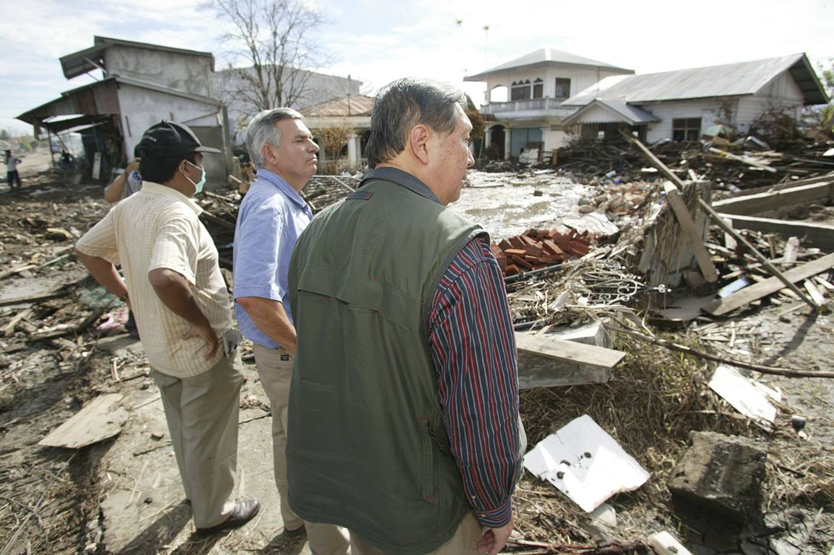 The Revs. David Wu (right) and R. Randy Day (center) of the United Methodist Board of Global Ministries view damage to Banda Aceh, Indonesia, following the Dec. 26 tsunami that killed thousands in the region. In January, a delegation of mission and communications leaders from the church visited areas of Sumatra, Indonesia, near the epicenter of the earthquake that triggered the waves.  Photo by Mike DuBose, United Methodist News Service